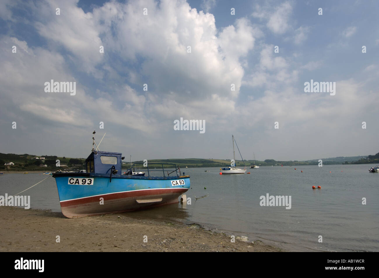 fishing boat at low tide at Gwbert Teifi Estuary 3 miles down river from Cardigan west wales, Stock Photo