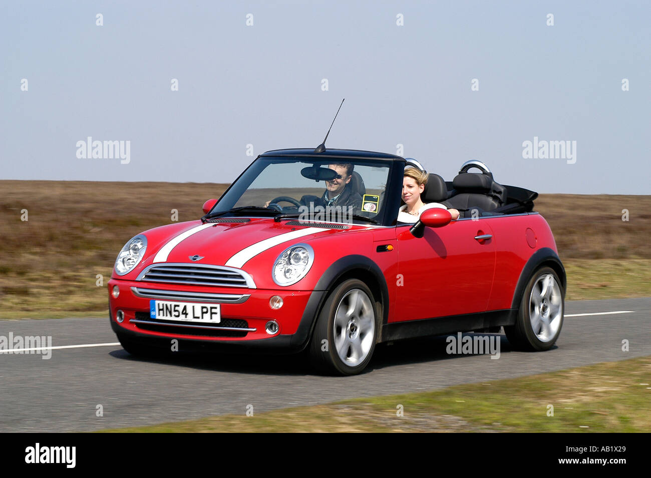 driving mini convertible stock photos driving mini. Black Bedroom Furniture Sets. Home Design Ideas