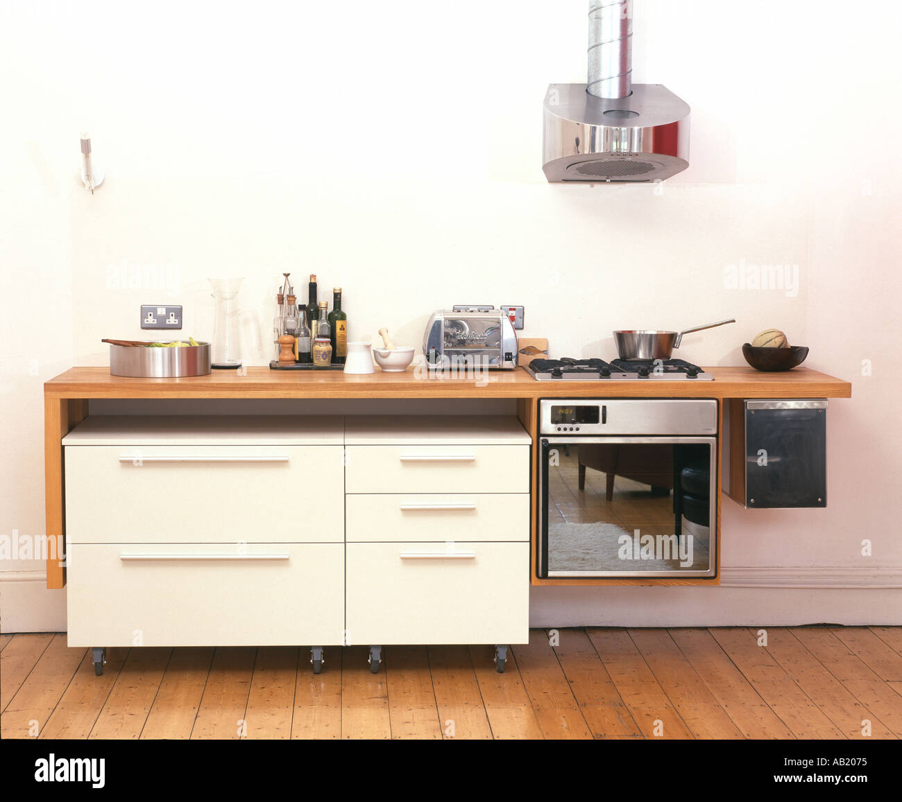 Small Modern Urban Apartment Kitchen, Small Bar Style Worktop And Moveable  Drawers