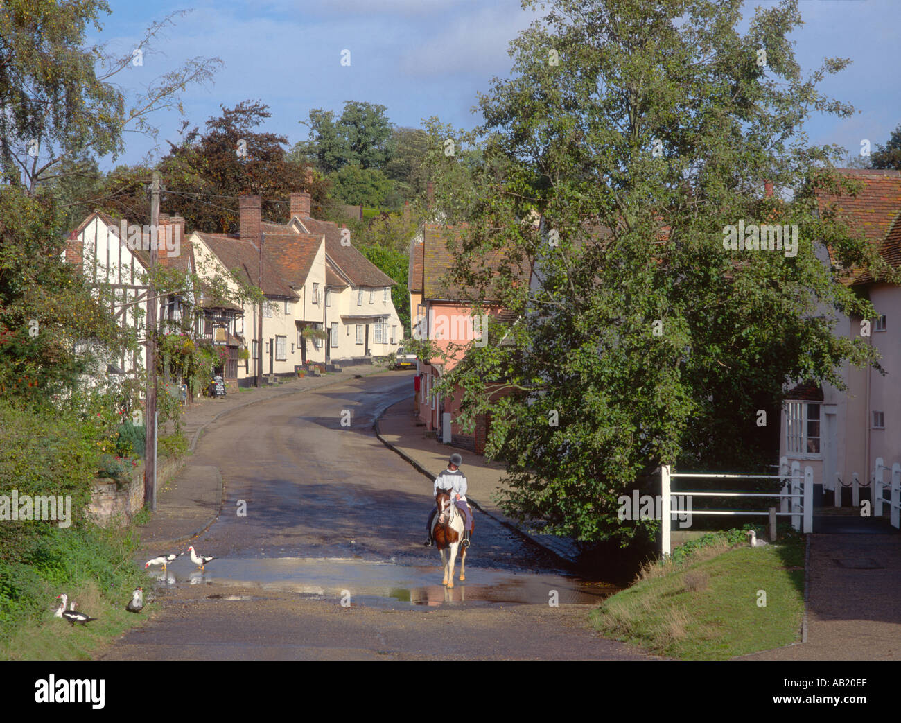Horse Rider Crossing Village Ford At Kersey In Suffolk England UK