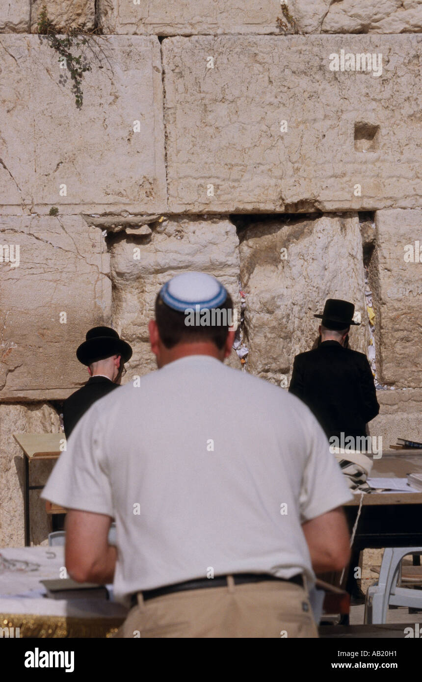 Men at the wailing wall Western Wall The Kotel al Buraq Wall Jerusalem Stock Photo