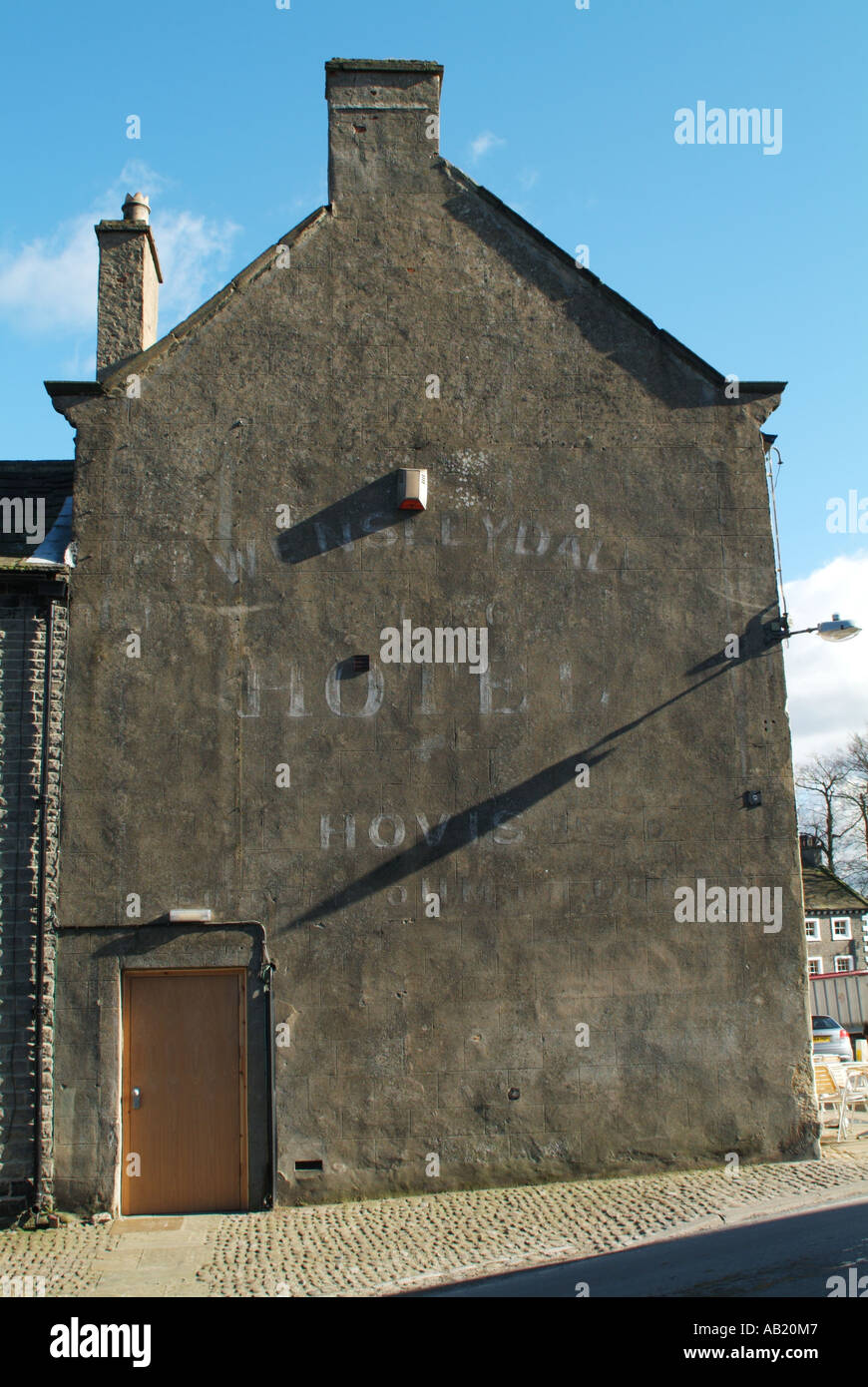 Old advert for Hovis bread on the gable end of the White Swan Hotel, Middleham, North Yorkshire, England, UK. - Stock Image