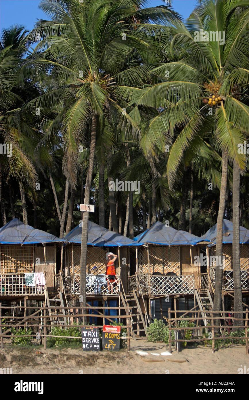 Bungalows on stilts among palm trees at beach palolem south goa india
