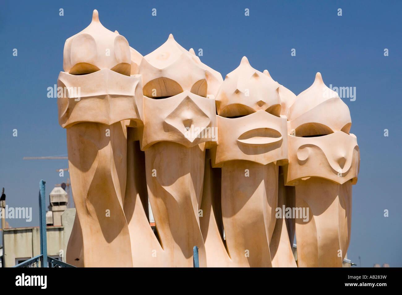 Sculptural chimneys on roof of Casa Mila La Pedrera by Antoni Gaudi built between 1905 1911 Barcelona Spain - Stock Image