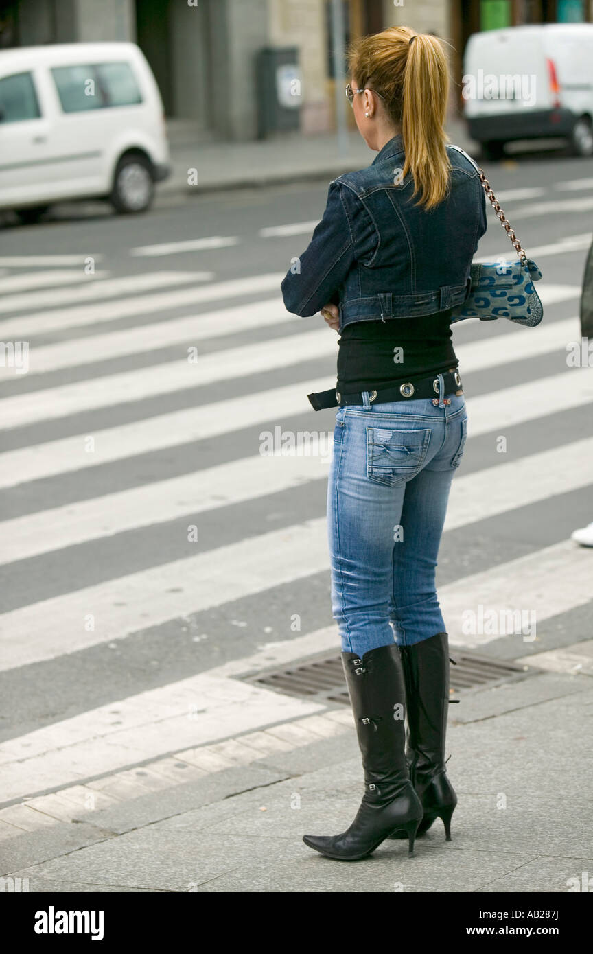 6f82be4d42de Fashionably dressed woman in black boots with high heels and tight jeans in  Bilbao Bilbo the North Coast of Spain