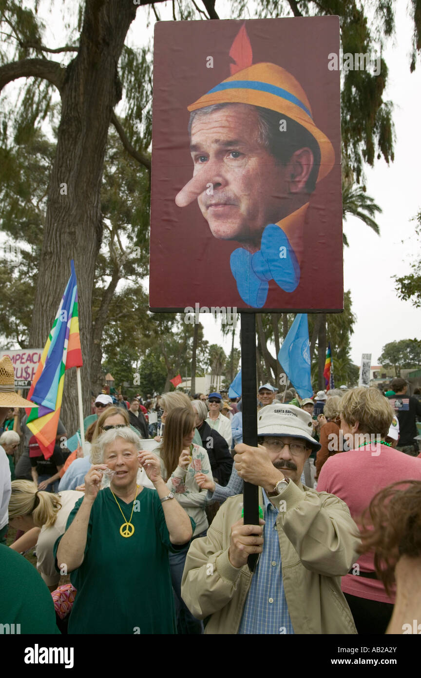 Depiction of President George W Bush as Pinocchio painted on a sign at an anti Iraq War protest march in Santa Barbara - Stock Image