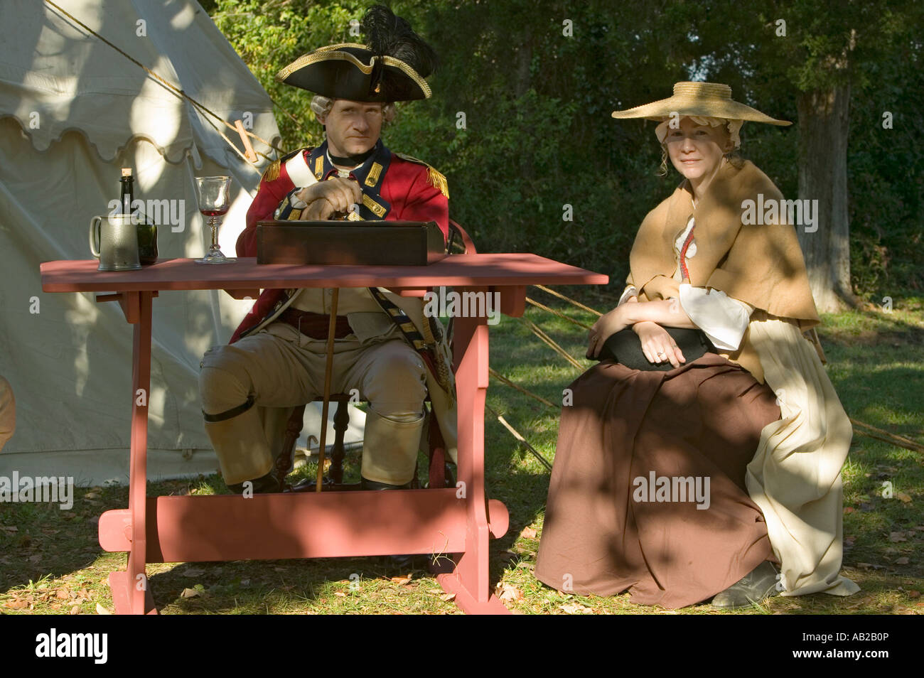 British Officer and his wife sit in Yorktown Virginia as part of the 225th anniversary of the Siege of Yorktown - Stock Image