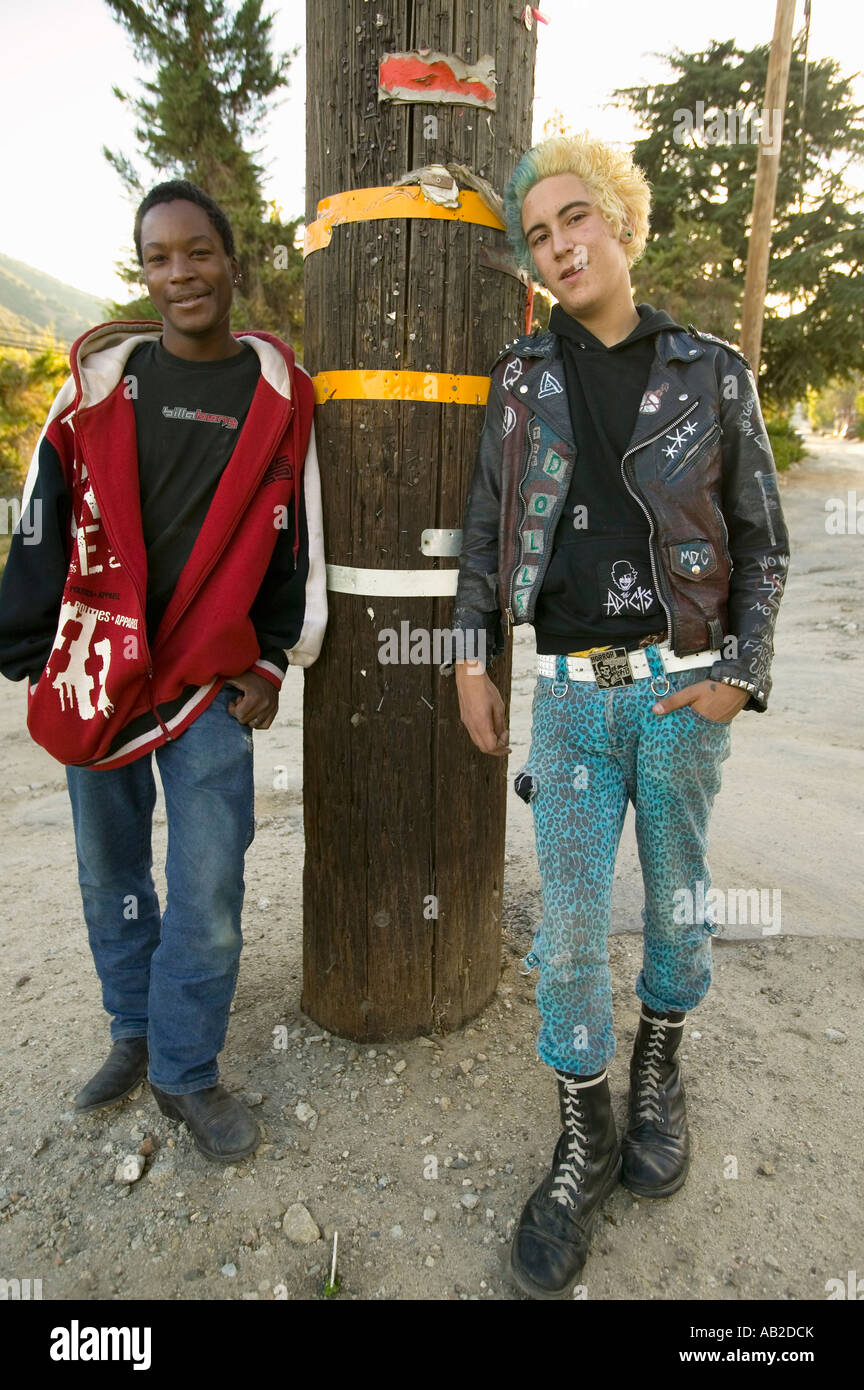 Punk teenagers one with blond and blue hair the other an African American in Frazier Park California - Stock Image