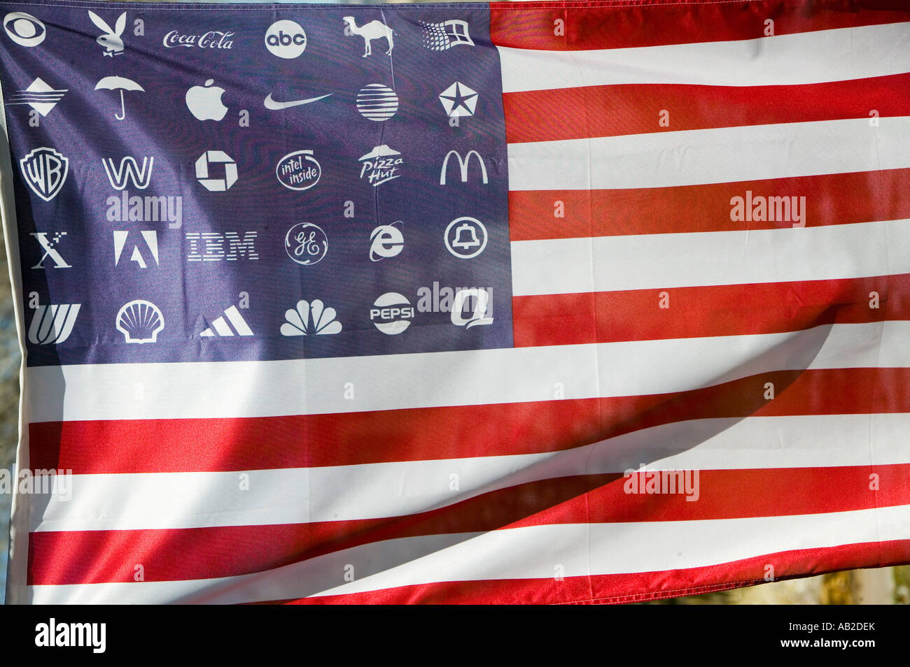 2a3d6e02887 Corporate logos in place of stars on the American flag symbolize allegiance  to and dominance of Corporate America