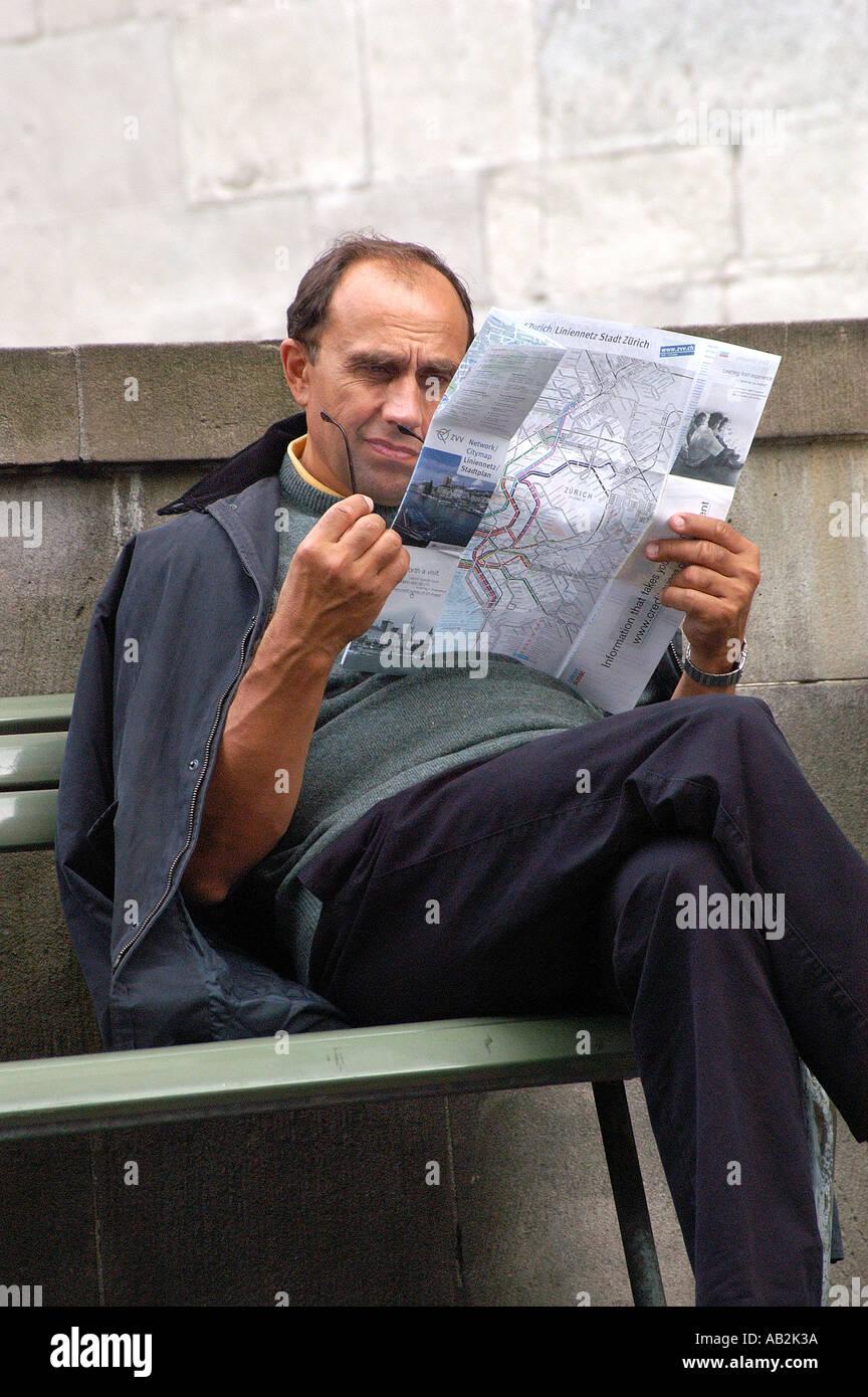Tourist read map Zurich Switzerland Stock Photo