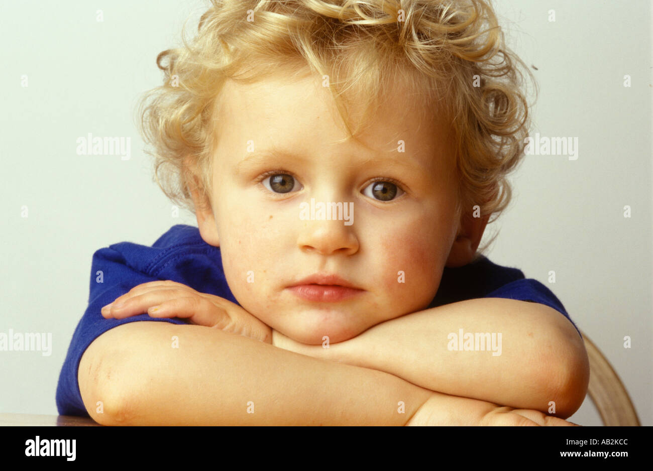 portrait of young boy looking angelic - Stock Image