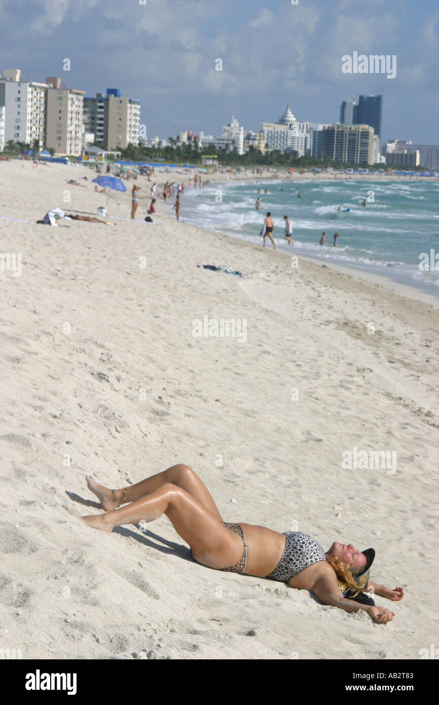 sunbather travel sunbathing south beach holiday vacation sunny relax calm peaceful - Stock Image