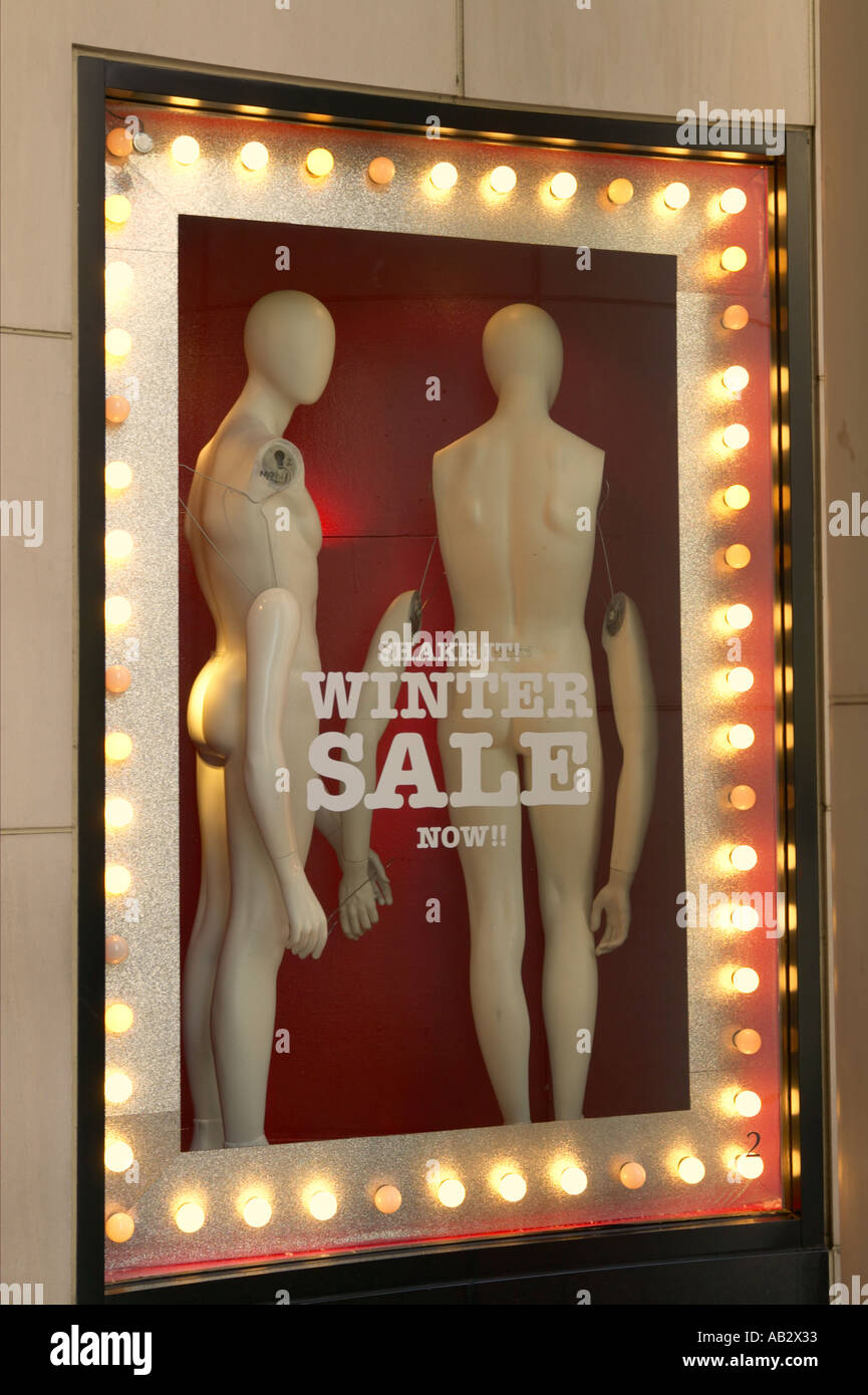 Mannequins in a shop window - Stock Image