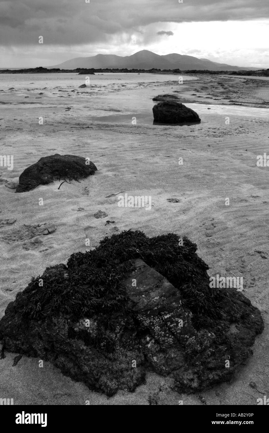 looking across Dundrum Bay from Minerstown beach to the Mountains of Mourne, County Down, Northern Ireland - Stock Image