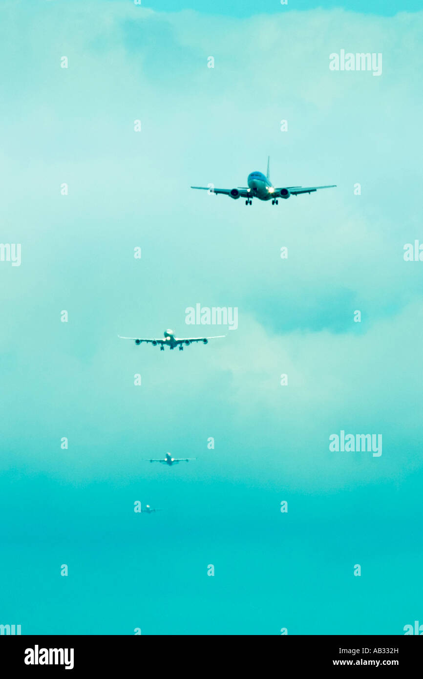 Commercial airplanes in a queue for landing - Stock Image