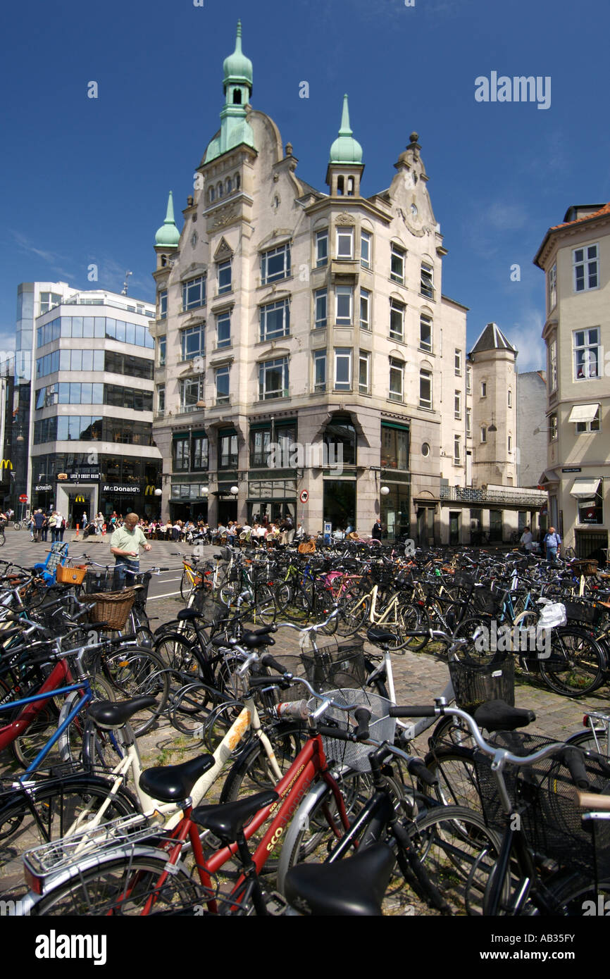 Bicycles parked on the Hojbro Plads plaza where it meets Amagertorv in Copenhagen Denmark. - Stock Image