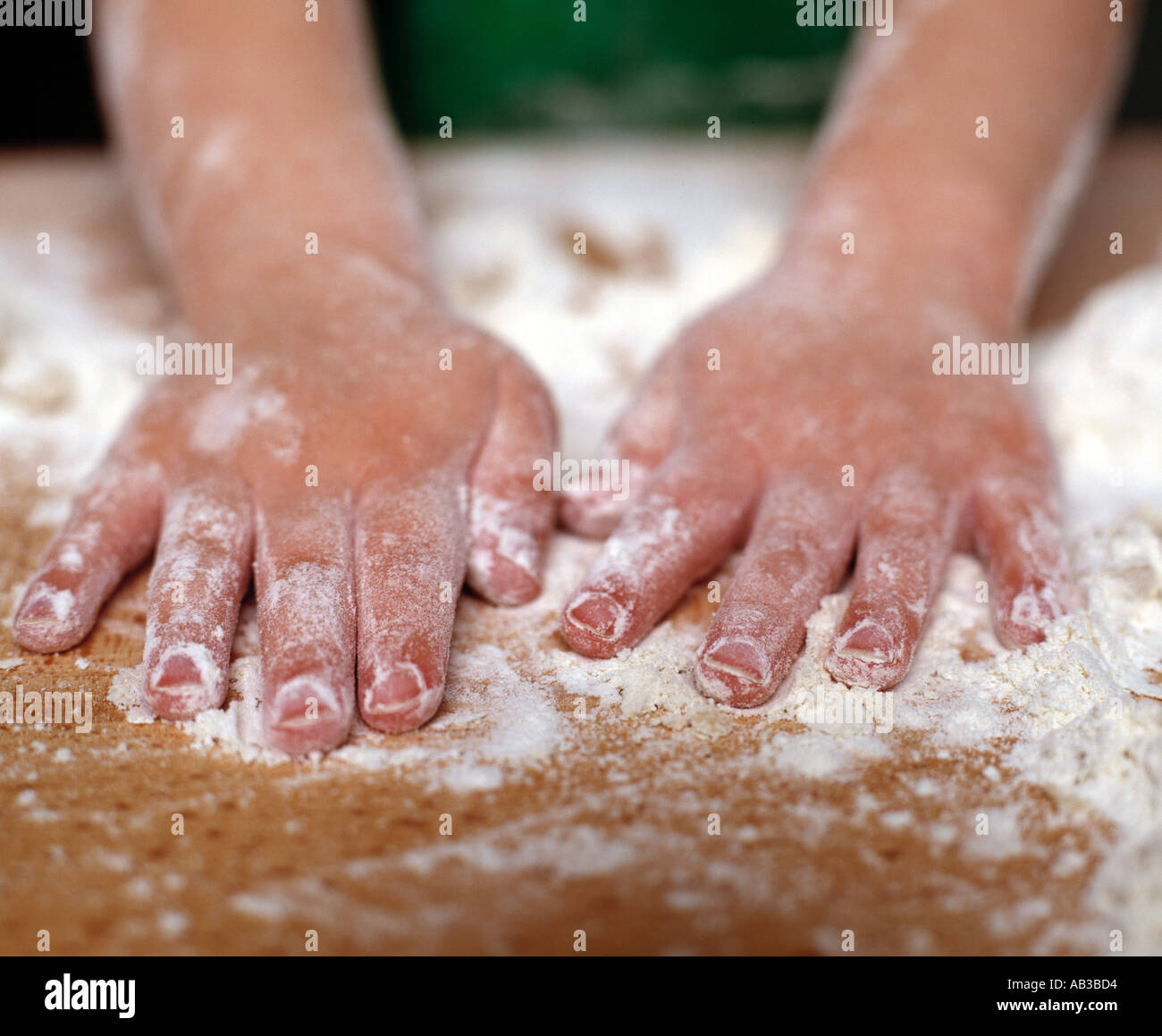childs hands in flour cooking - Stock Image