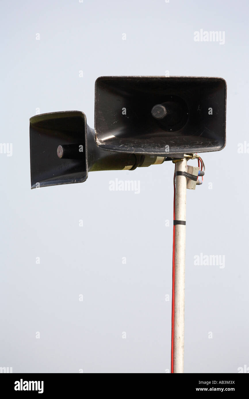 public pa address system speakers on a metal pole - Stock Image