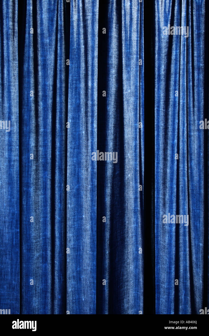 pattern of backlit blue curtain - Stock Image