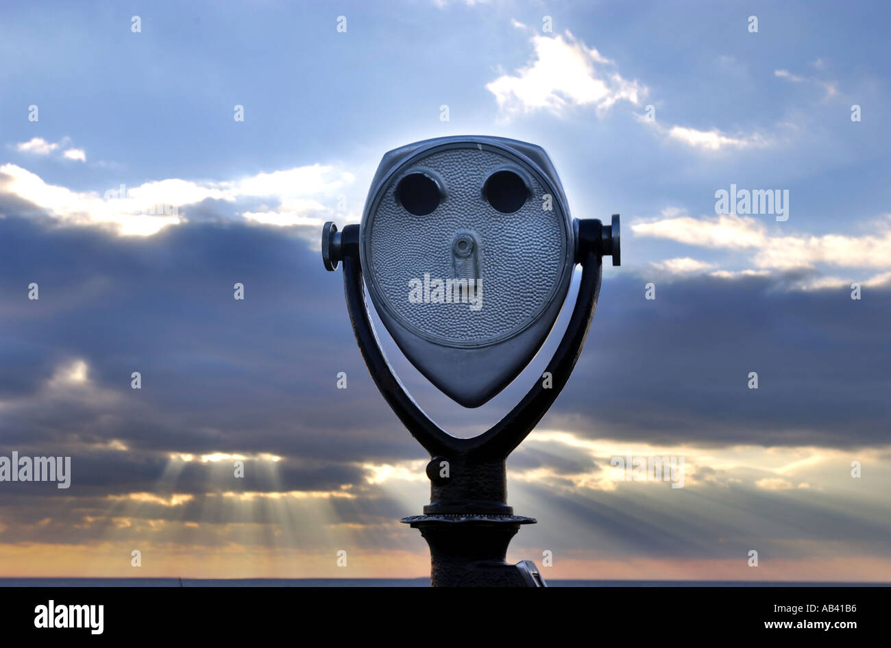 Pay scope at scenic spot with sunset - Stock Image