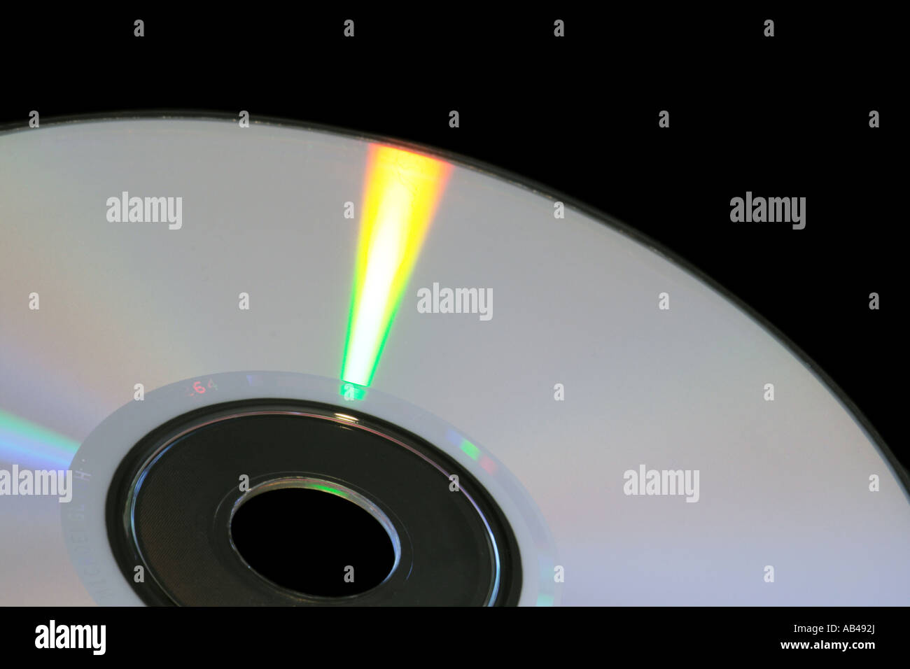CD-ROM or DVD with rainbow reflections over a black background Stock Photo