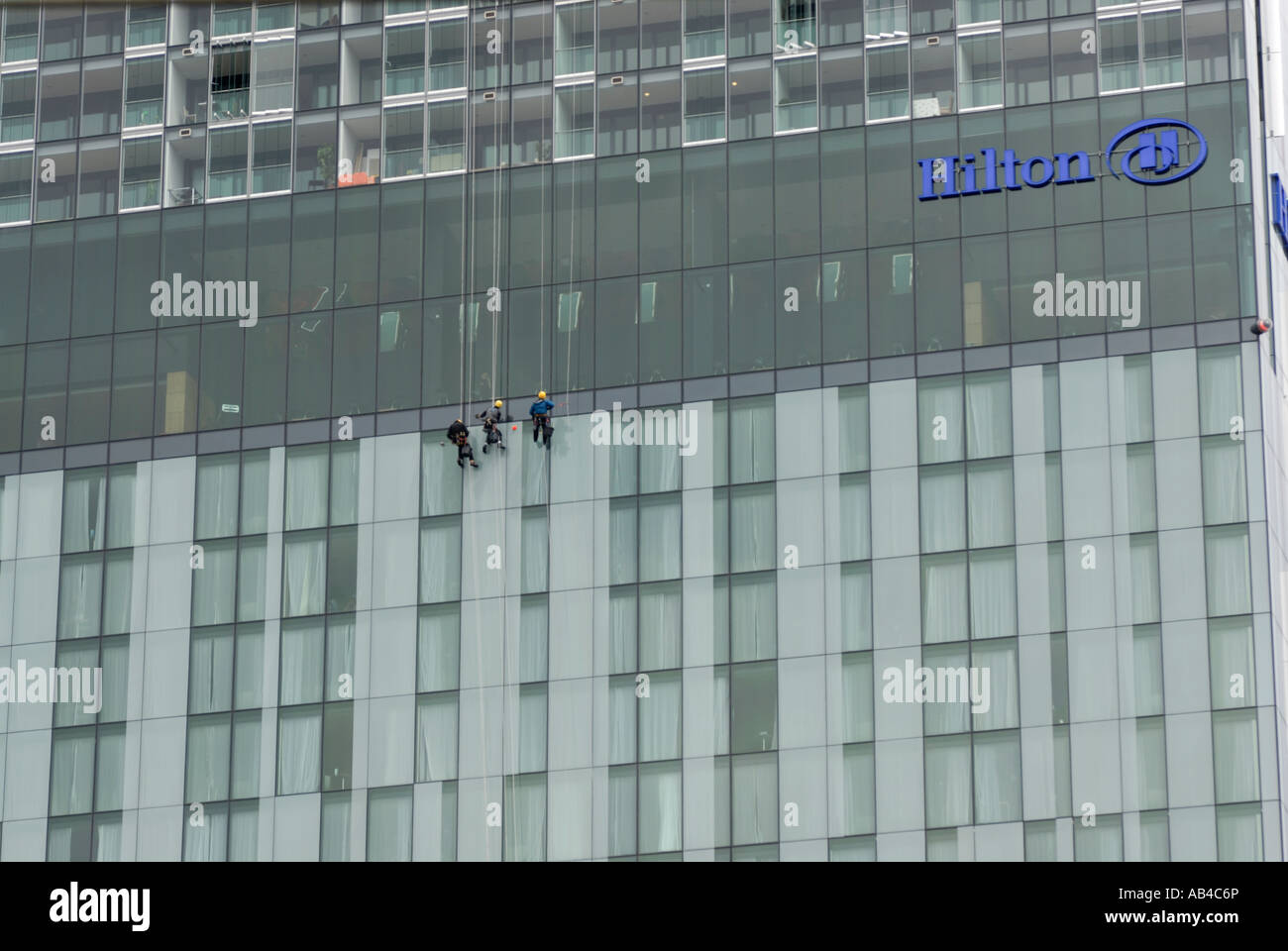 Three workers carrying out an abseil inspection the Beetham Tower, the tallest structure in Manchester UK - Stock Image