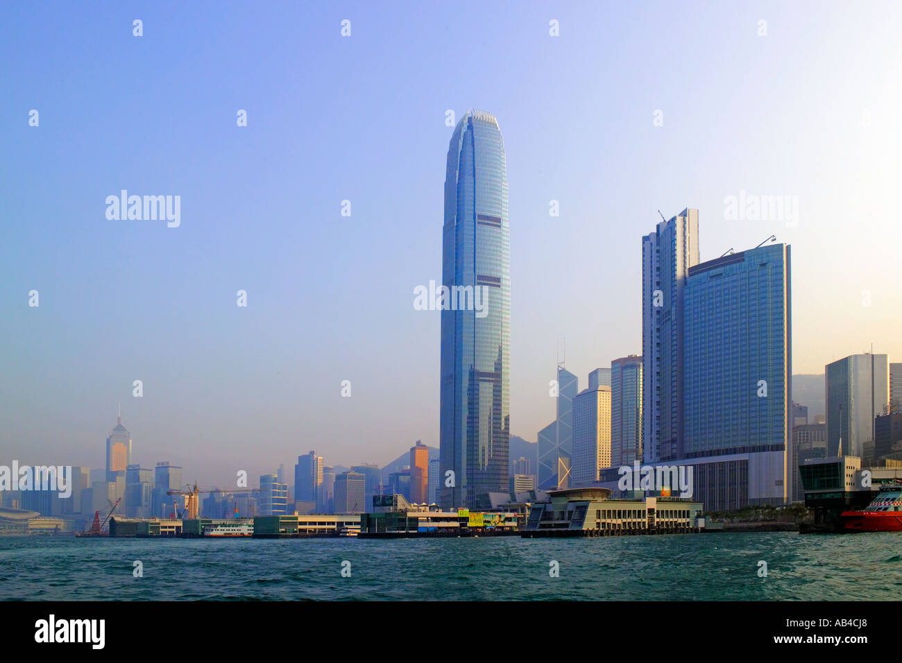 A view of skyscrapers on Hong Kong Island over Victoria Harbour with the IFC building (tallest in Hong Kong) prominent. - Stock Image