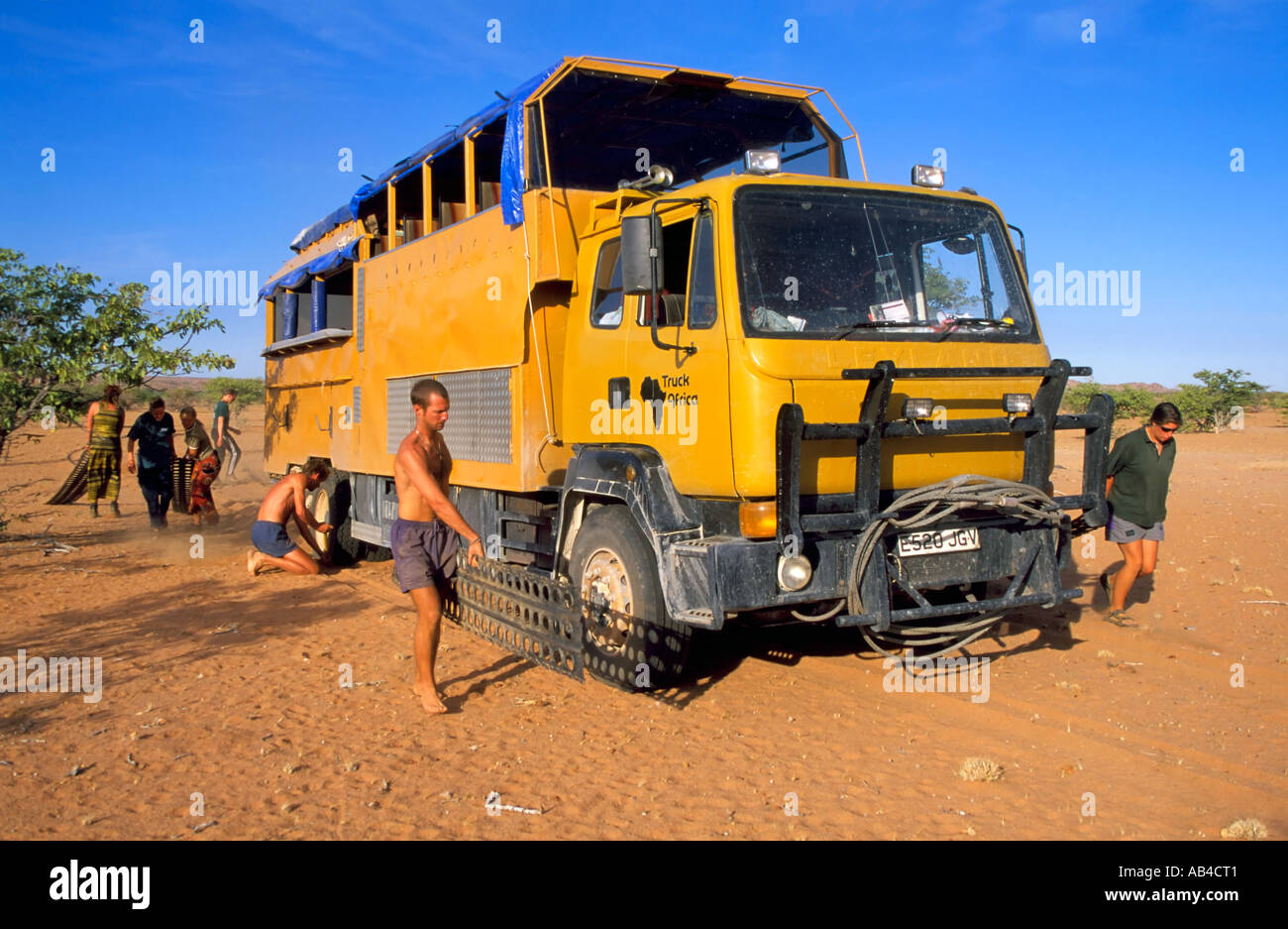 Tourists On An Overland Trip To Namibia Help To Dig The Truck Out Of Stock Photo Alamy