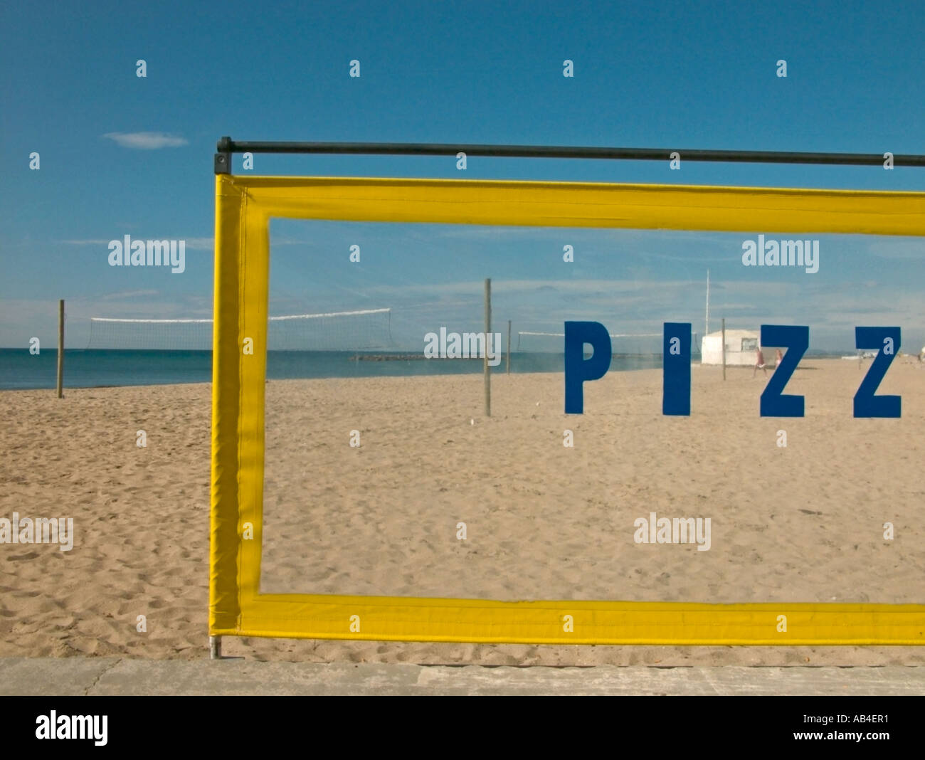 looking through a pizza snack bar wind shield onto a beach, france. - Stock Image