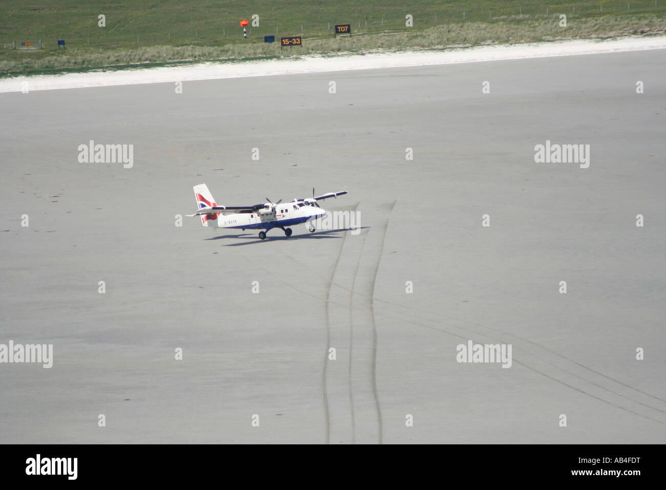 propeller plane landing on beach runway Barra airport Isle of Barra Outer Hebrides Scotland  June 2007 - Stock Image