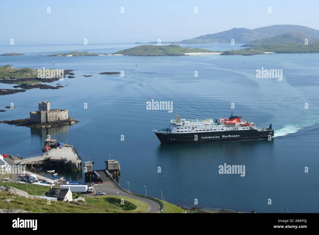 Clansman part of the Caledonian MacBrayne fleet arriving at Castlebay with Kisimul castle isle of Barra Scotland - Stock Image