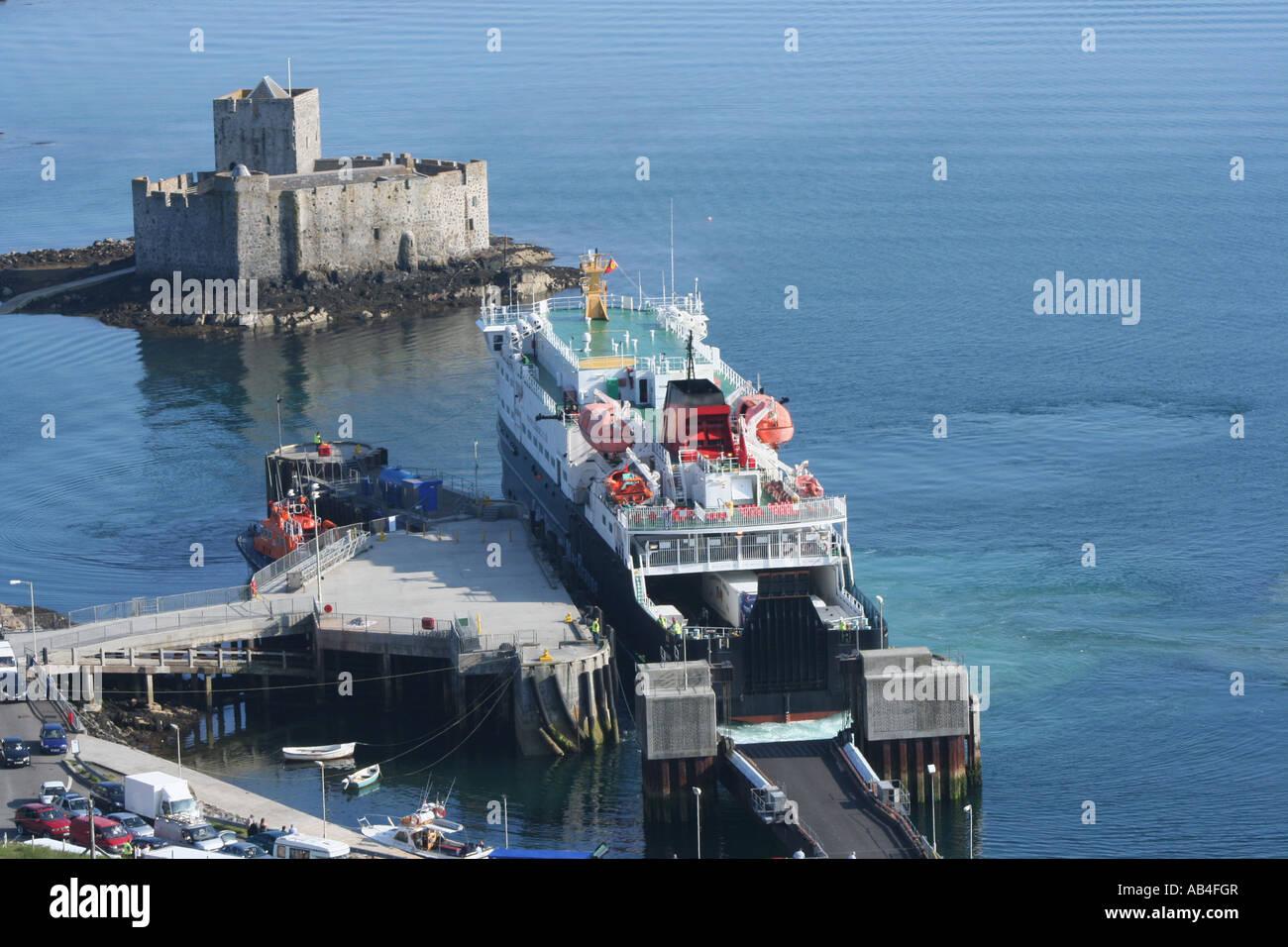 Clansman part of the Caledonian MacBrayne fleet docking at Castlebay with Kisimul castle isle of Barra Scotland - Stock Image