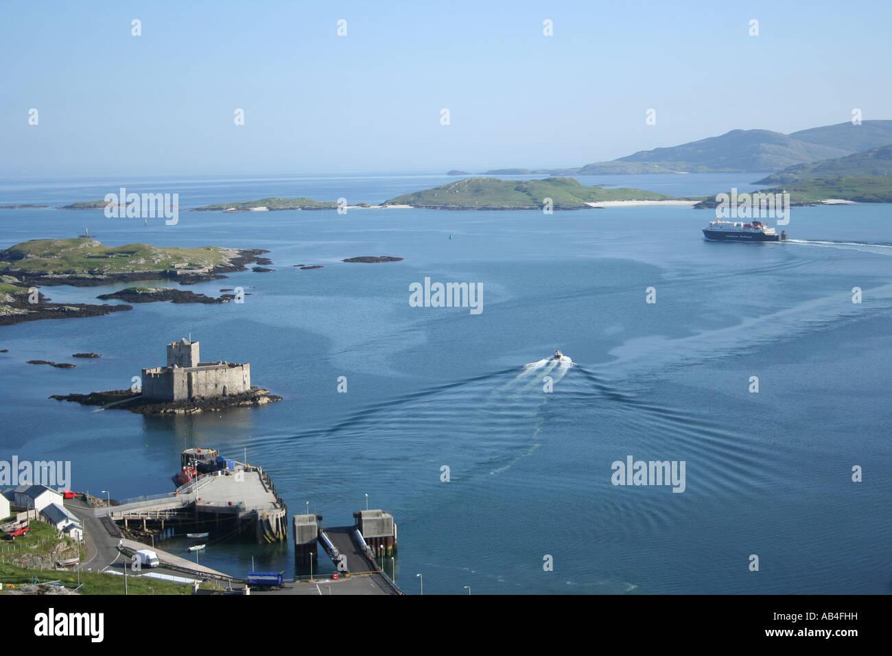 Clansman part of the Caledonian MacBrayne fleet leaving Castlebay with Kisimul castle isle of Barra Scotland  June - Stock Image