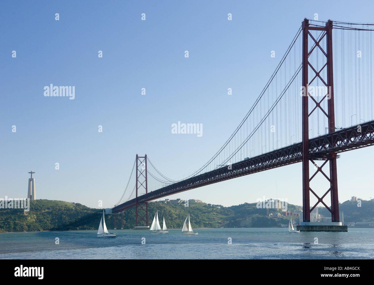 25th Of April Bridge & Bom Jesu Monument - Stock Image