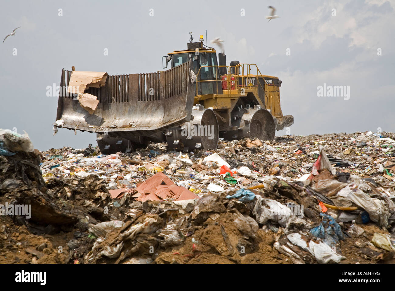 Marshall Michigan A bulldozer levels newly arrived garbage at the C C Landfill - Stock Image