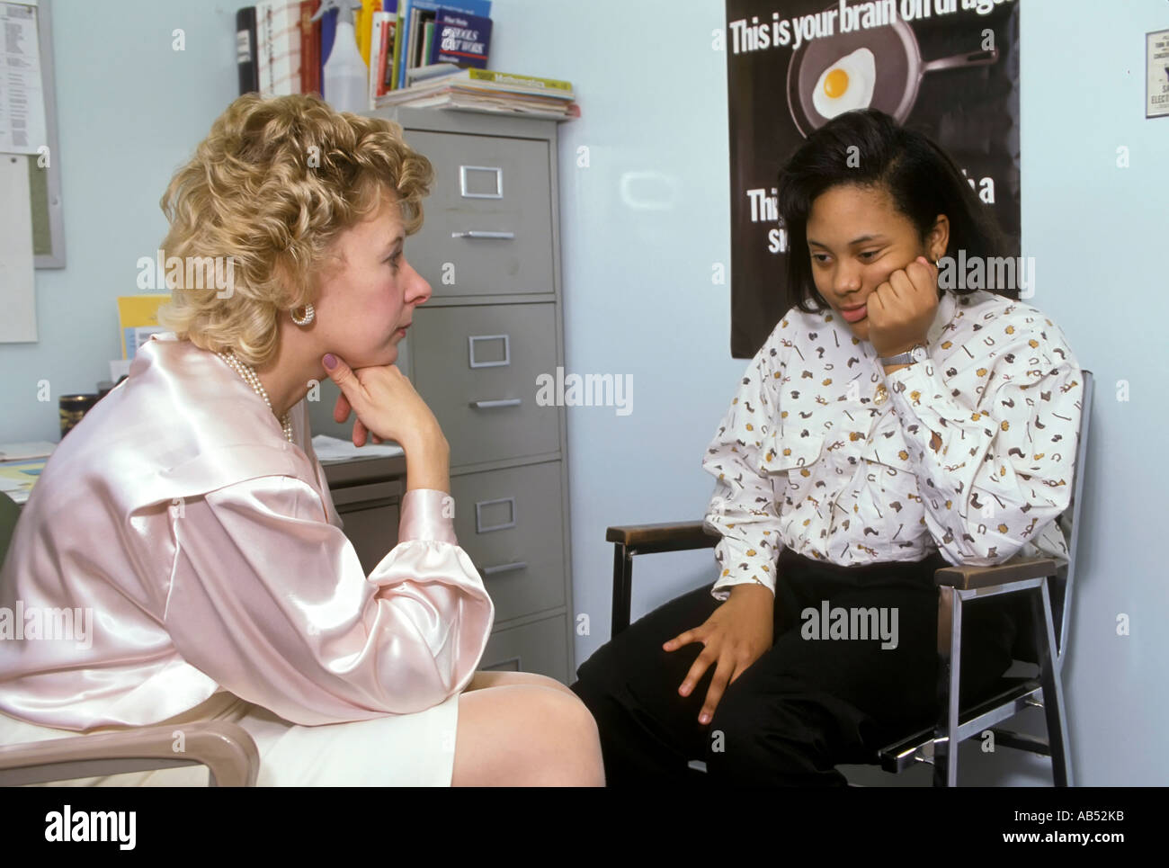 Middle School Guidance Counselor Meets With A Teen Female Student In