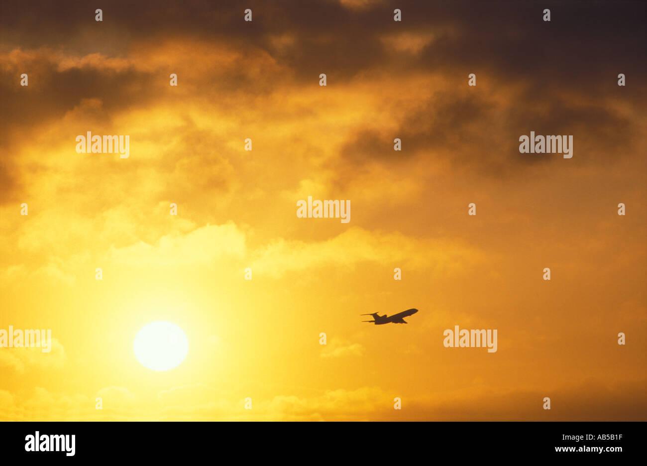 Aircraft in Sky at Sunrise Heathrow England UK - Stock Image