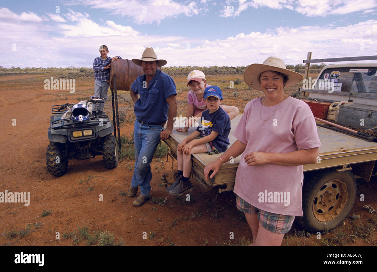 Outback family waiting for flying mailman, Langidoon Station, near Broken Hill, New South Wales, Australia, horizontal, - Stock Image