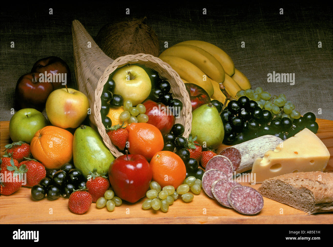 CORNUCOPIA of fruit with salami cheese and bread - Stock Image
