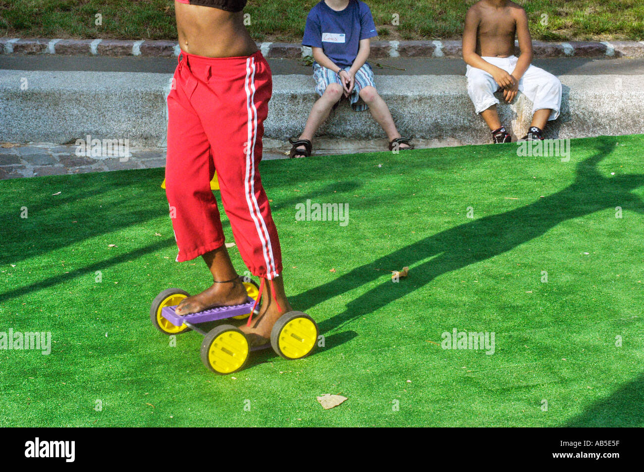 Multicultural French Children Playing with Plastic Roller Skates on 'Paris Plages' 'Festivals in France' River Seine plage - Stock Image