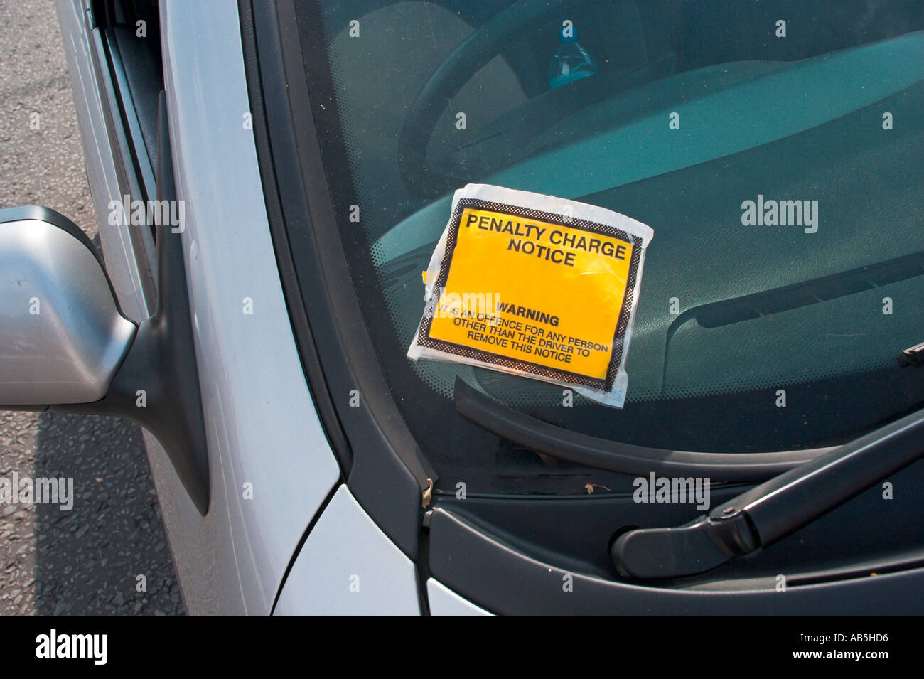 Penalty Charge Notice ticket on parked car in London England - Stock Image