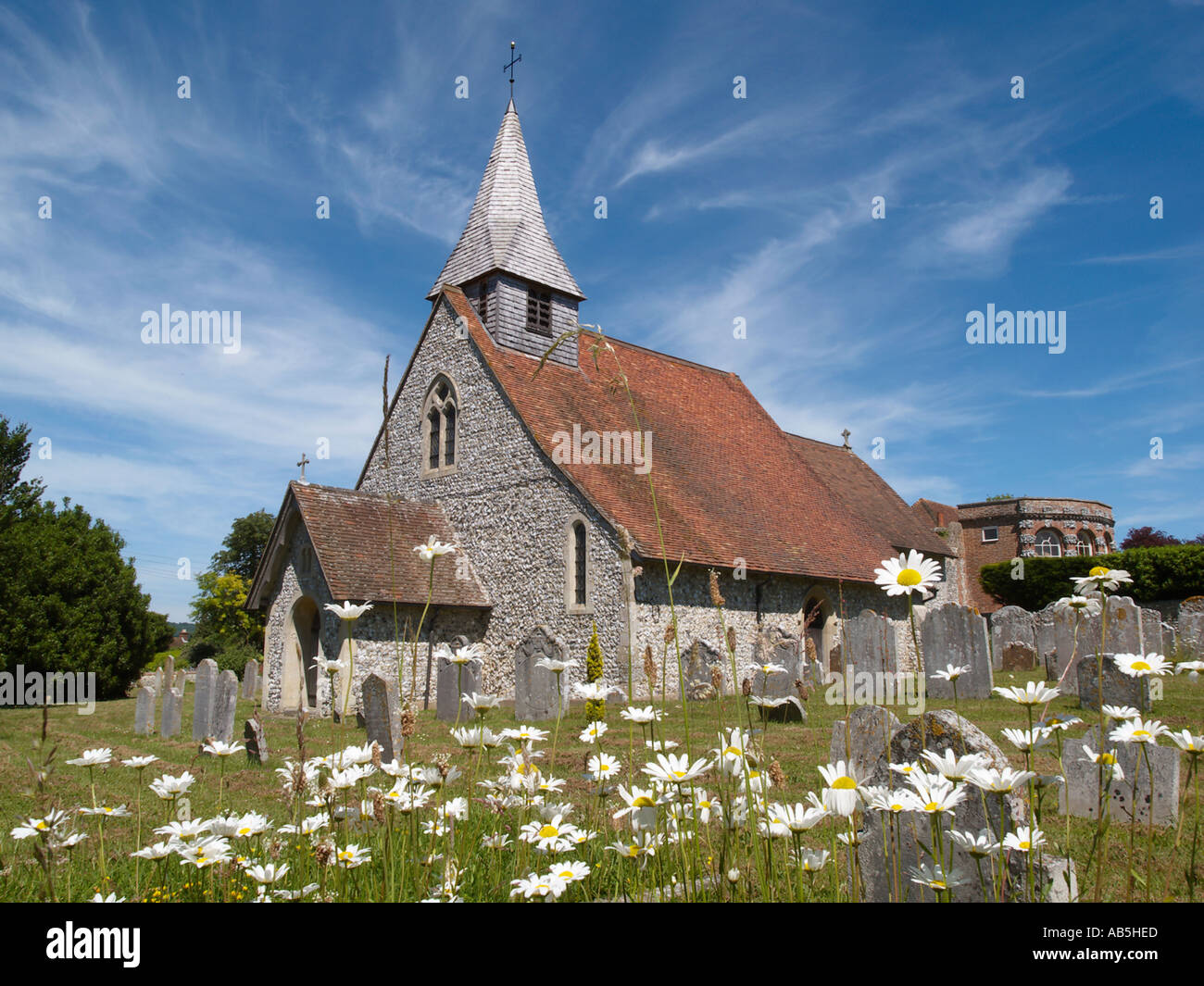 Country church of St Margaret with shingled bellcote and Oxeye Daisies. Eartham West Sussex England UK Britain Stock Photo