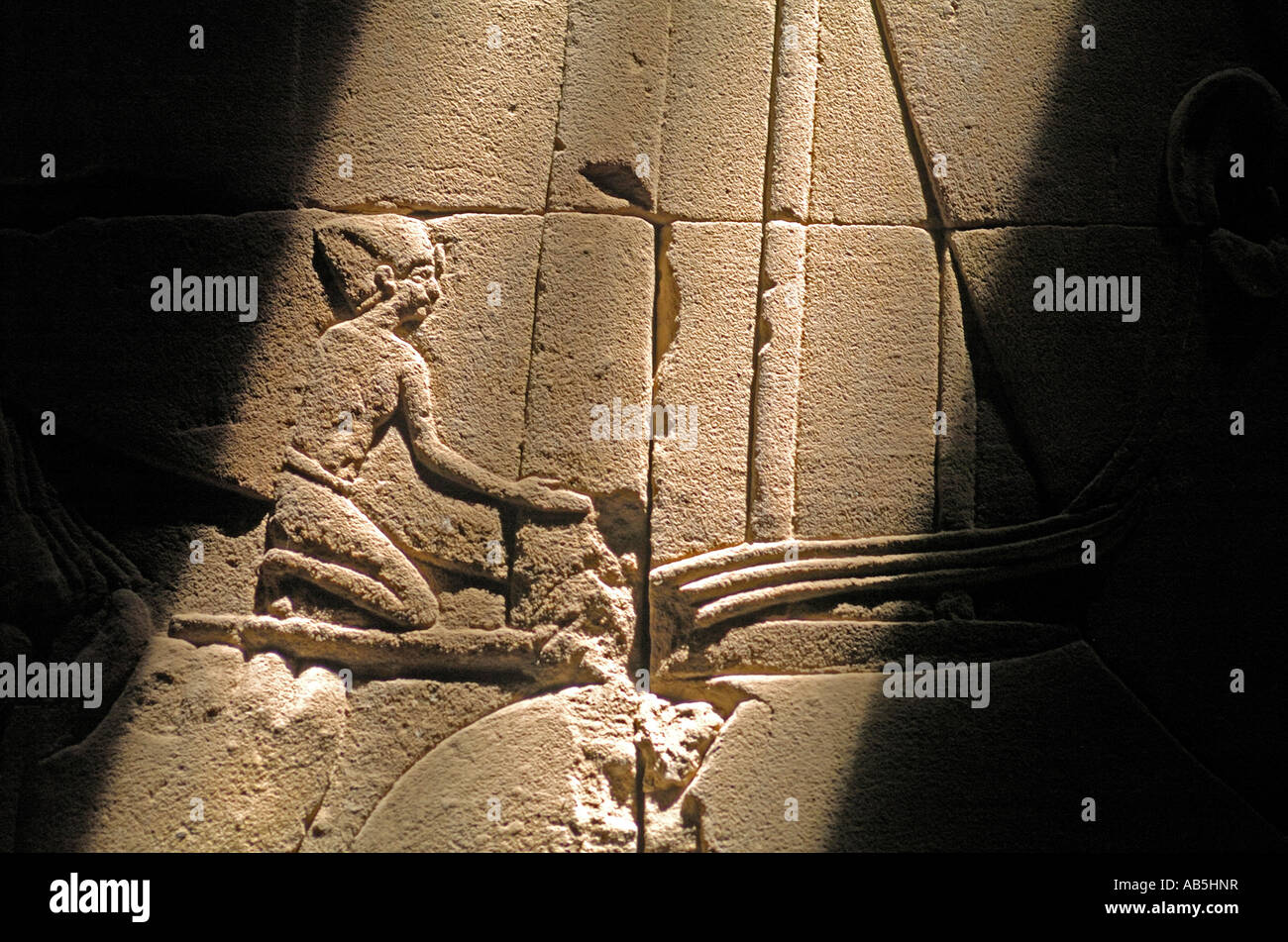 Shaft of light on relief carvings in edfu temple egypt the