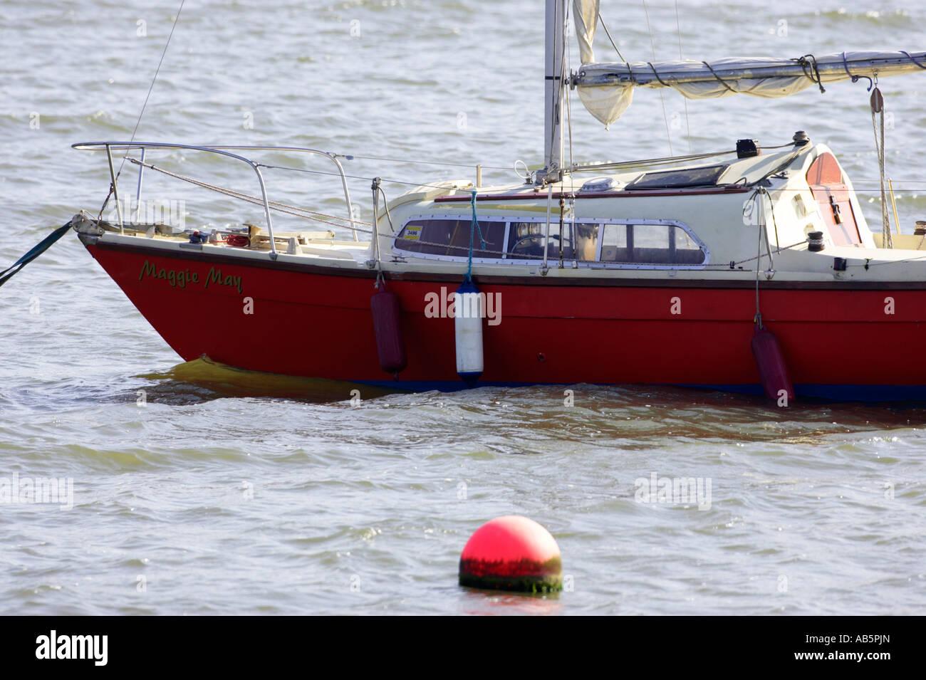 small yacht sailboat tied up at berth in carlingford lough - Stock Image