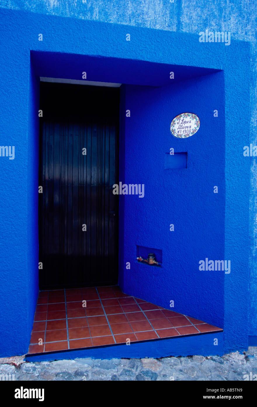 entry door with blue trim, Barrio Xochimilco, capital city, Oaxaca, Oaxaca de Juarez, Oaxaca State, Mexico, North - Stock Image