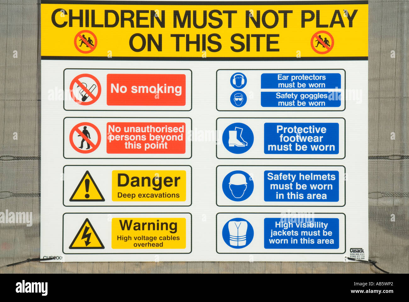 Sign on fence outside building site warning children and listing site regulations - Stock Image