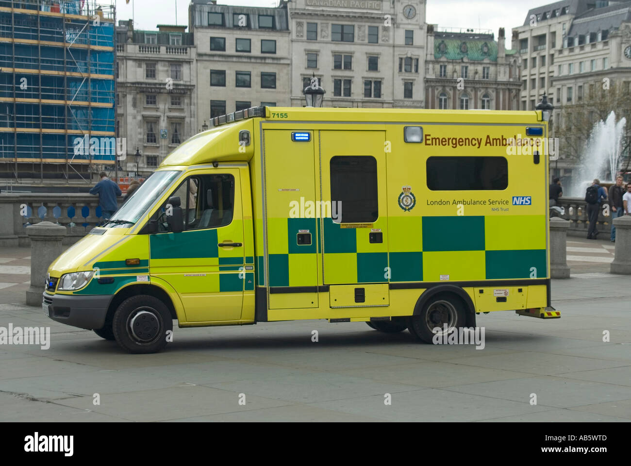 Trafalgar Square ambulance from the London Ambulance Service attending a 999 incident with patient being treated inside vehicle - Stock Image