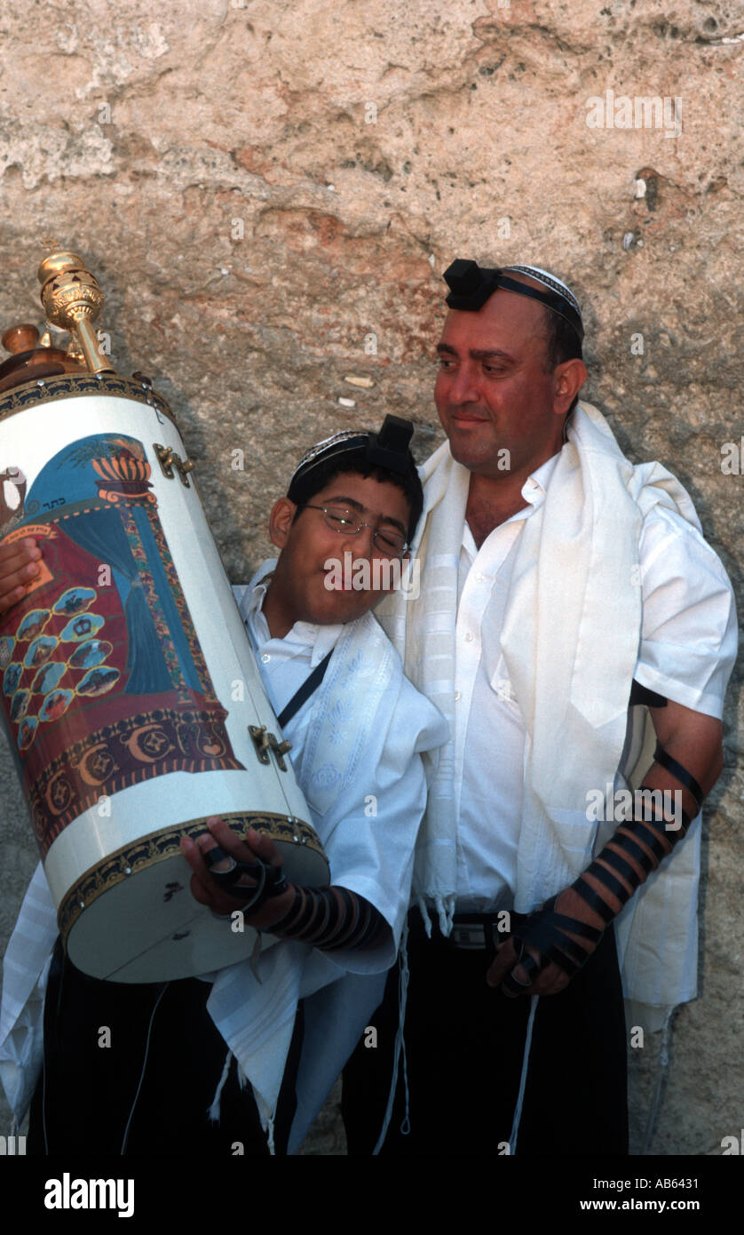 Father and Son in front of the wailing wall at the Bar Mitzva of the son - Stock Image