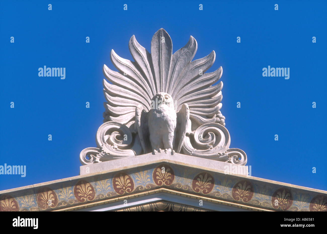 An Athenian owl with acanthus acroterion on a pediment of the Academy of Athens, Athens, Greece. - Stock Image
