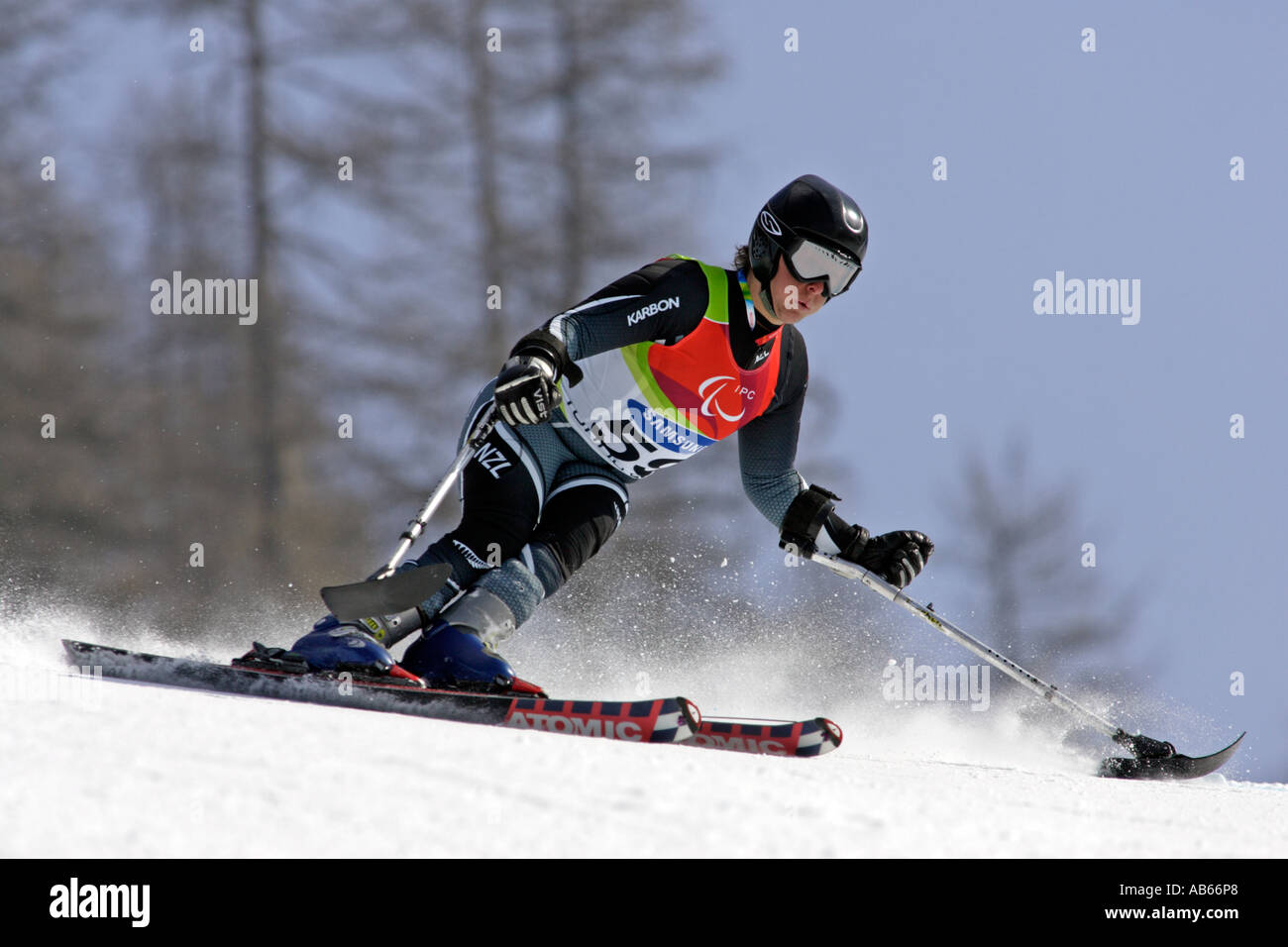 Adam Hall LW1 of New Zealand on his second run of the Mens Alpine Skiing Giant Slalom Standing competition - Stock Image